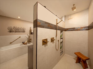 No-barrier master shower with bench for aging population by Schroeder Design/Build